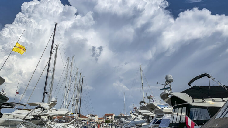 Wind (Bora, Jugo, Bura, Nevera / Neverin, Maestral), weather in the Adriatic Sea and Croatian Islands. A thunderstorm is moving over a marina.