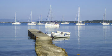 Shopping by dinghy: bay with anchored yachts